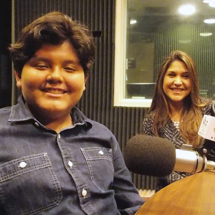 Veronica and Gabrielle Rios sitting in WFSU's radio studio in front of the mic